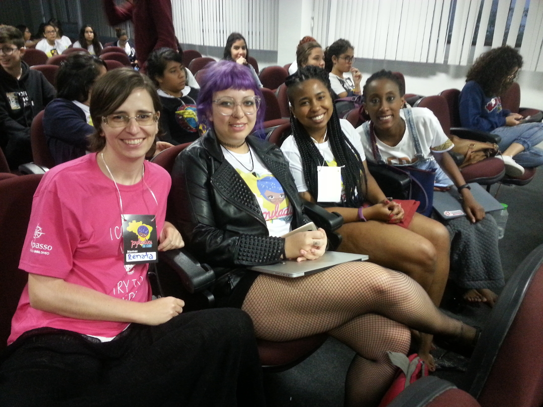 picture of PyLadies Porto Alegre at PyLadiesBRConf, four women sitting together in the audience